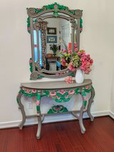 Finely carved half moon console table and matching mirror in Kingwood, Texas