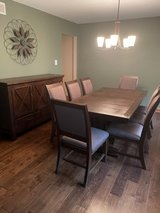 Dining table and chairs with server in Chicago, Illinois