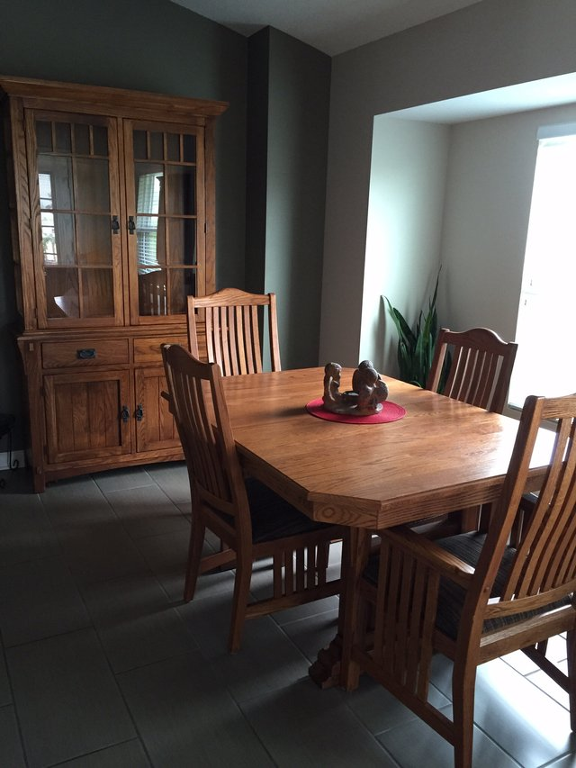 $200 Dining table with 6 chairs and hutch $200 Dining room